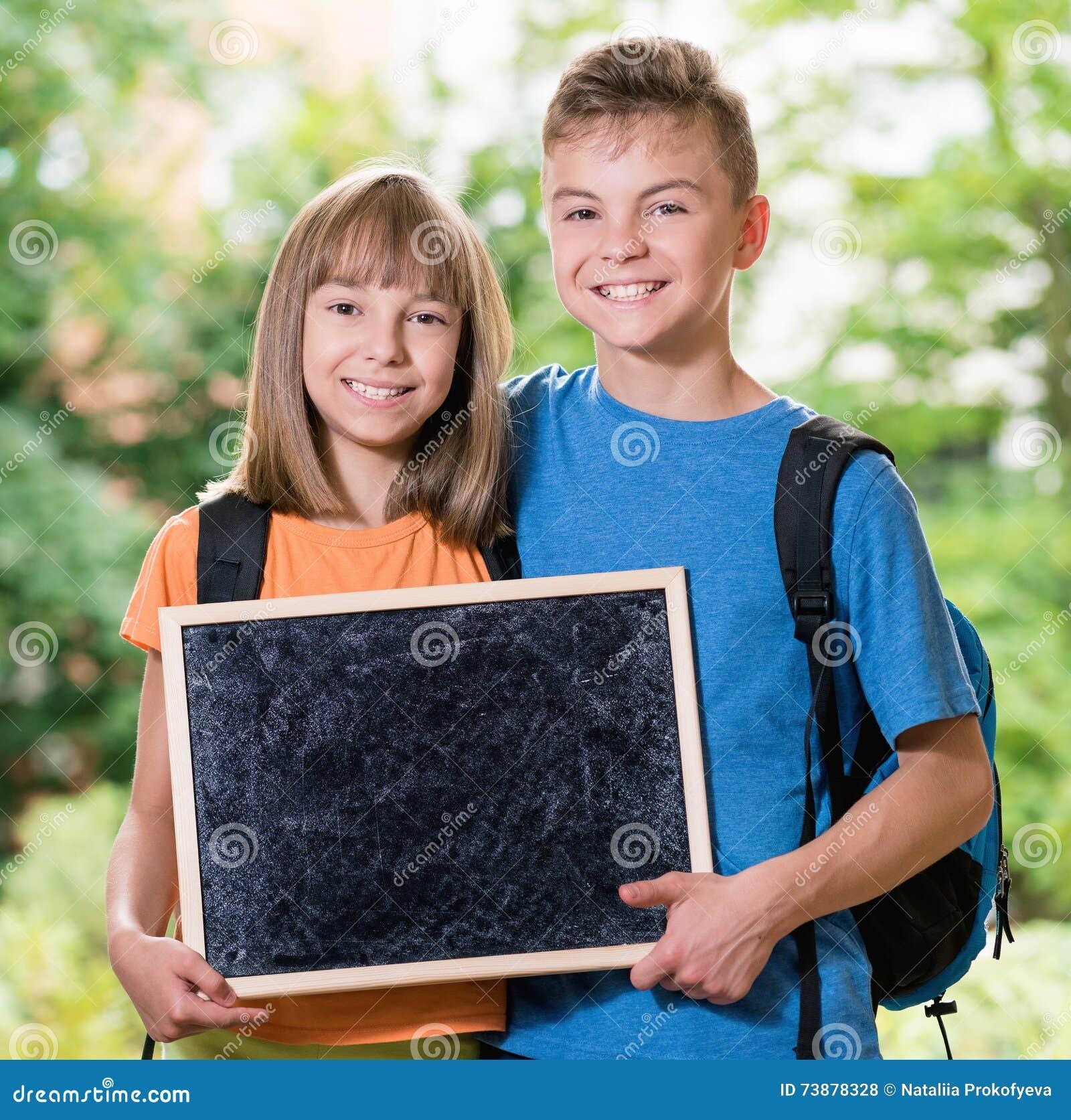Boy And Girl With Blackboard Stock Photo - Image of board ...