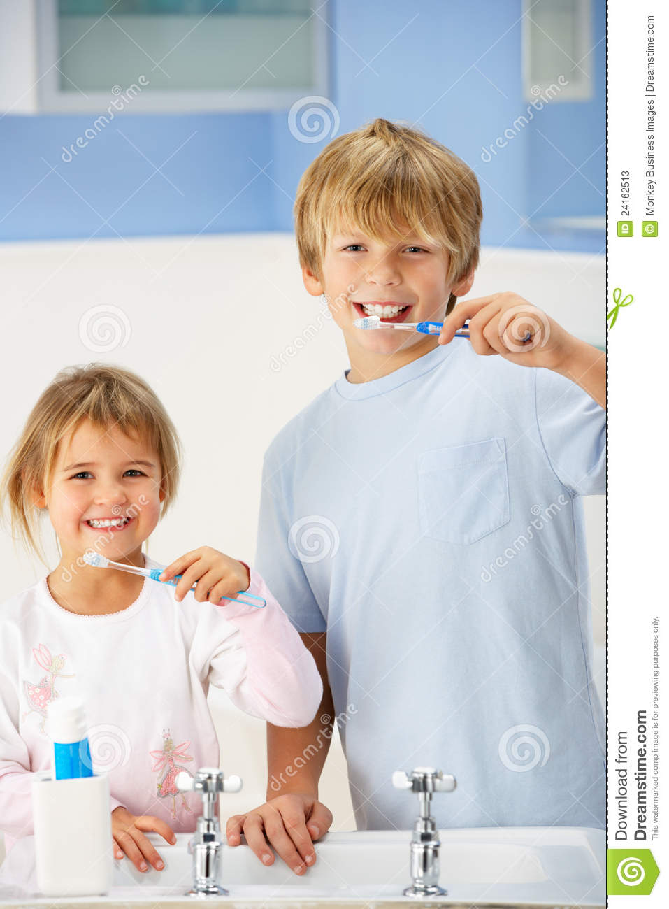 Boy and girl cleaning teeth in bathroom stock photos for Girls in bathroom with boys