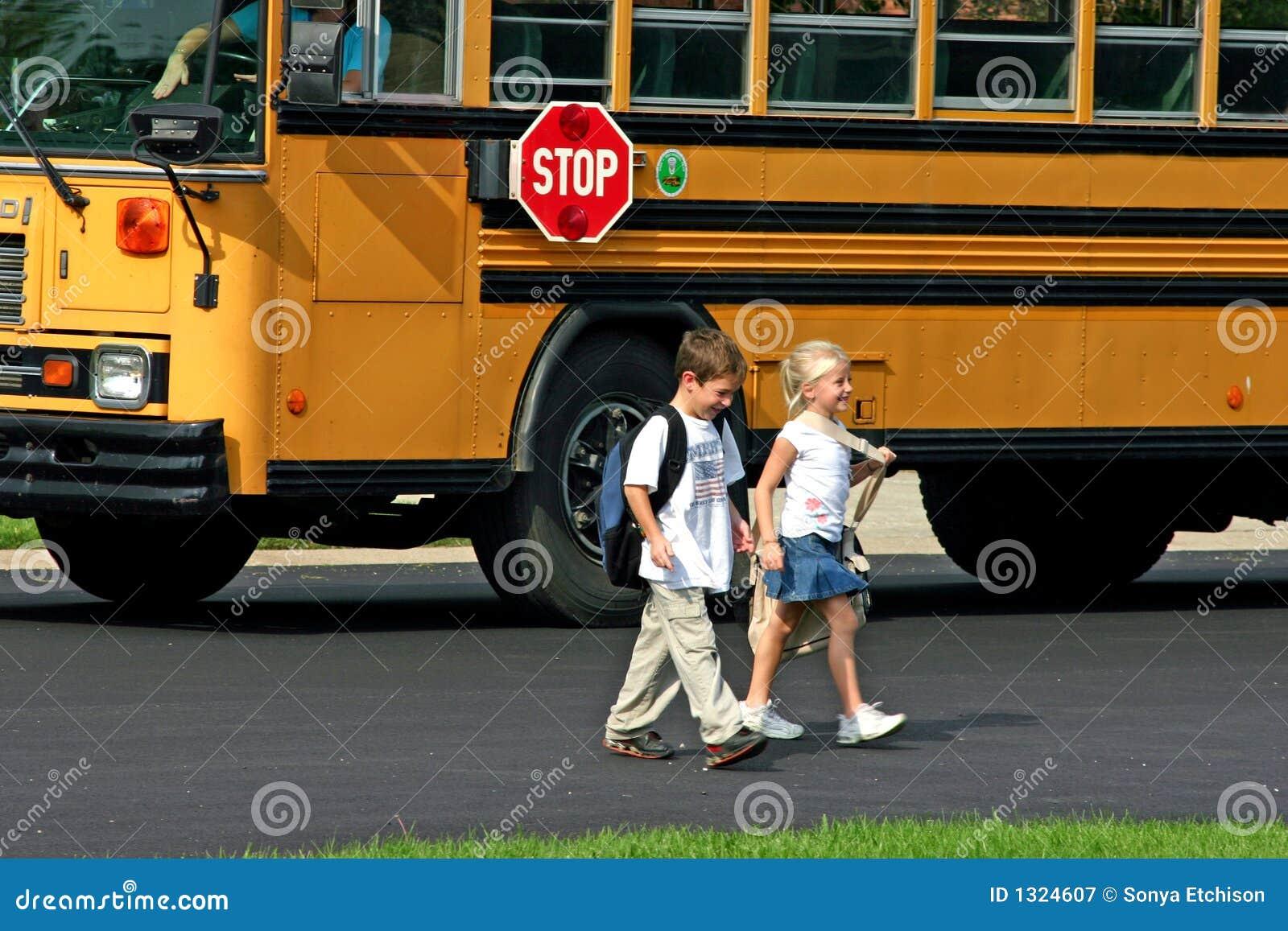 Boy and Girl Crossing Street