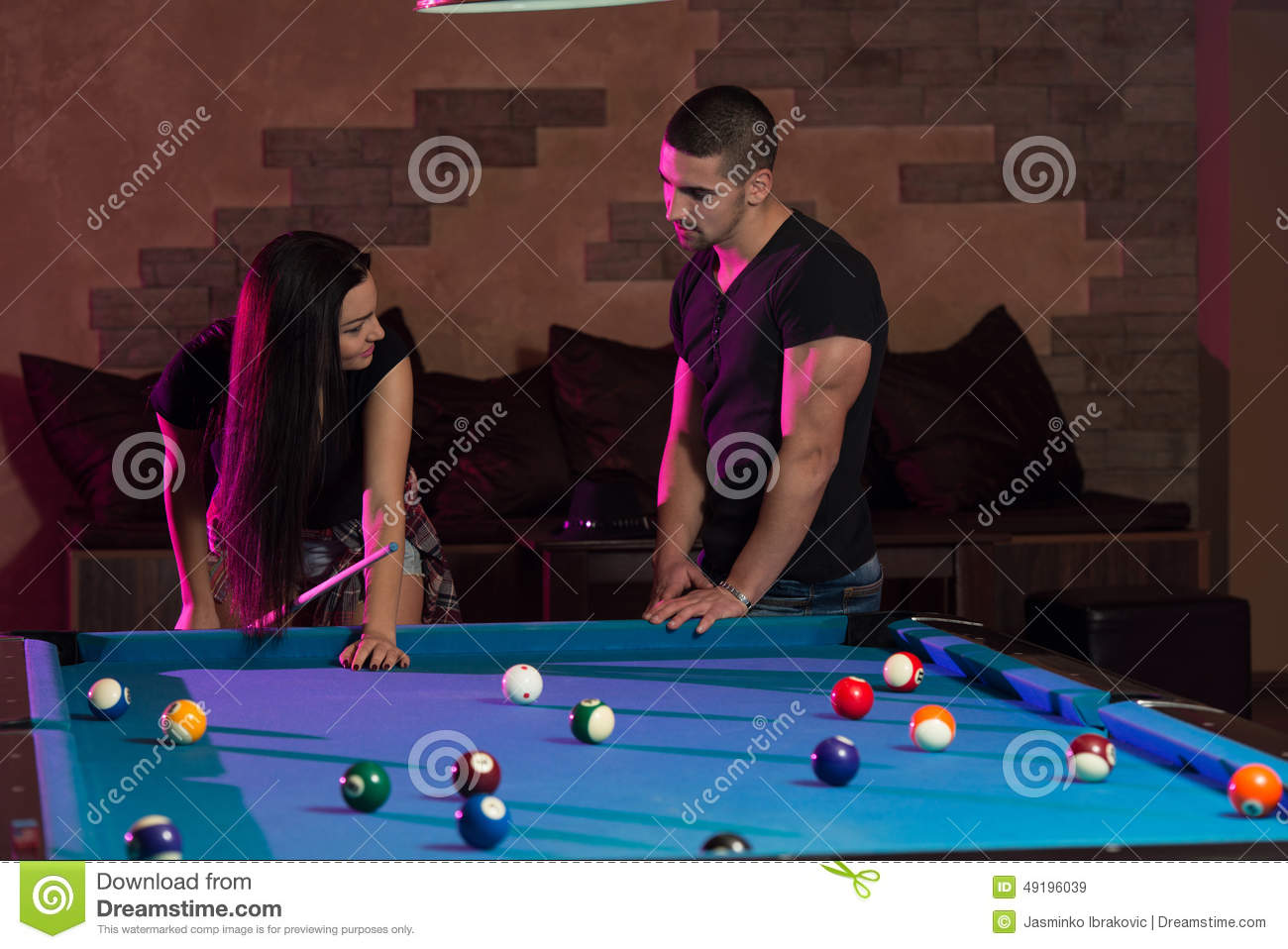 Boy And Girl Flirting On A Pool Game Royalty-Free Stock -1380