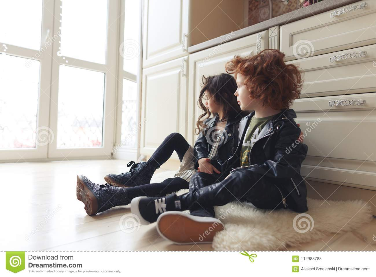 Boy and girl friends sit together on the floor