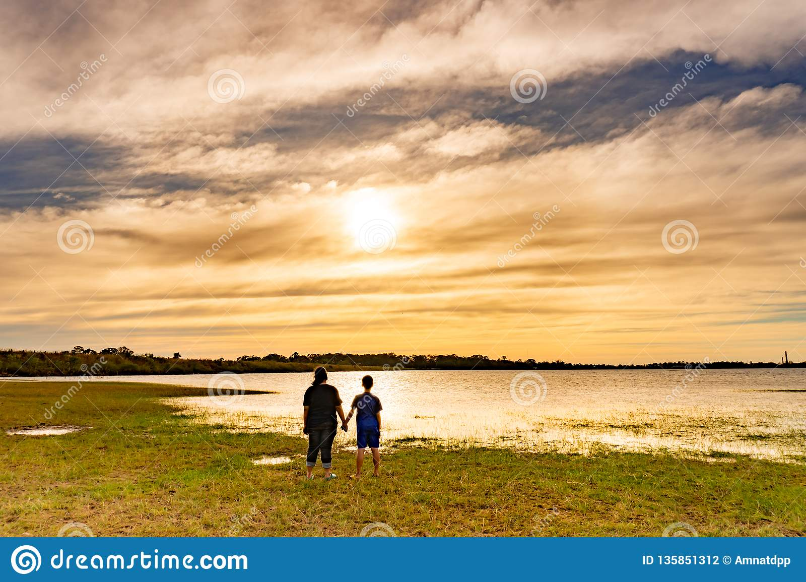 Boy and girl looking at sunset