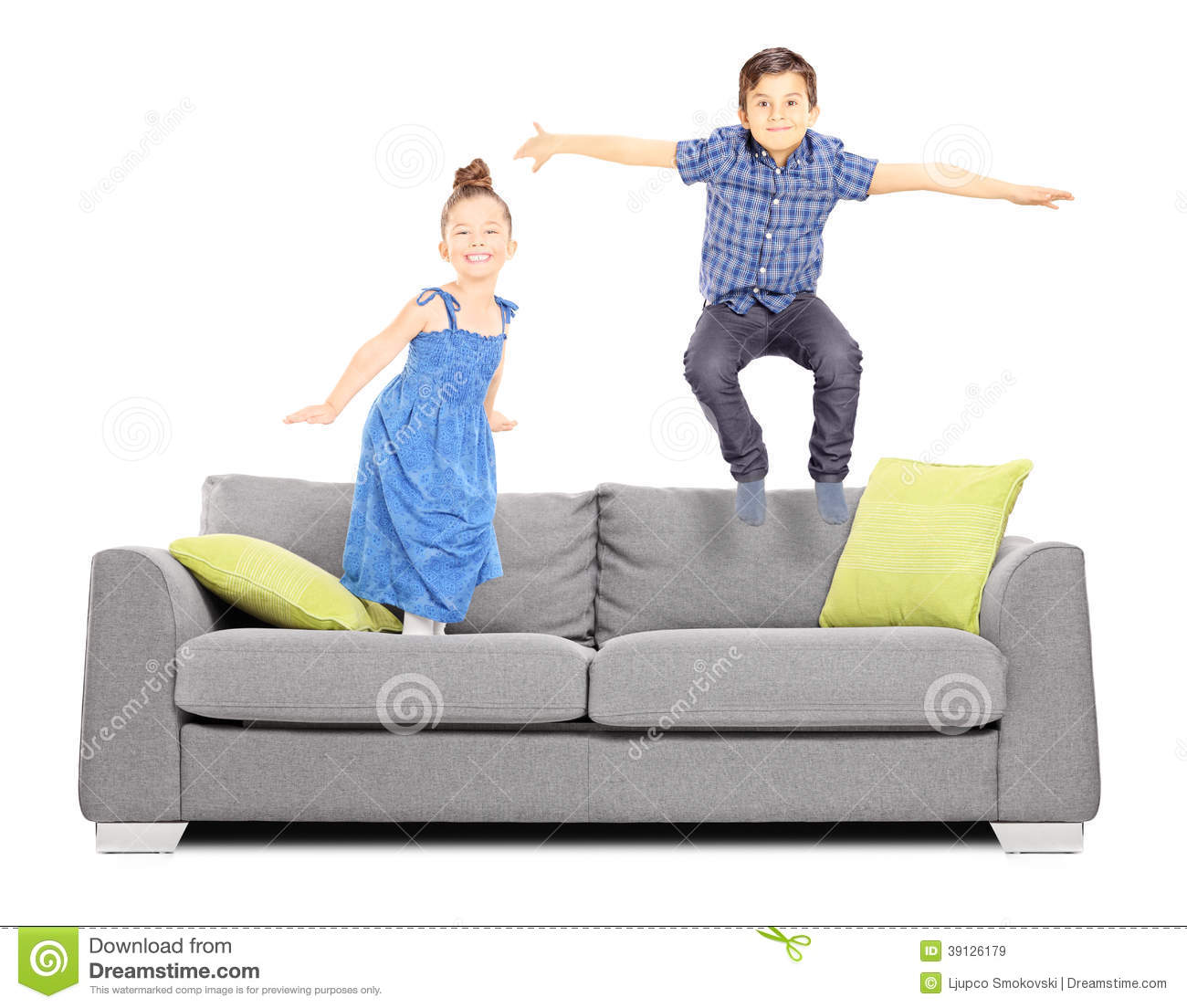 Boy And A Girl Jumping On The Couch Stock Photo Image