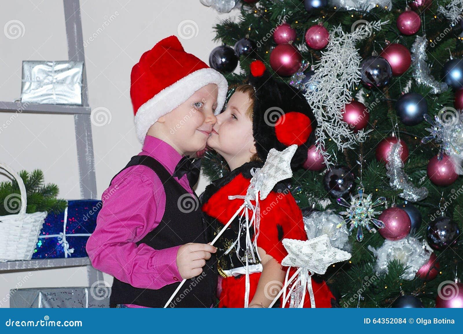 Boy And Girl Kiss Christmas Stock Photo - Image of photo ...