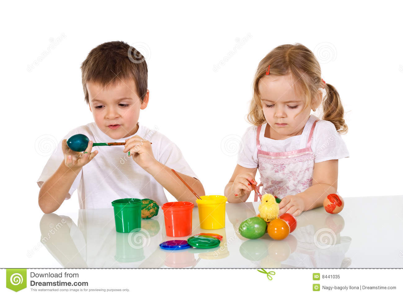 Boy and girl painting the easter eggs
