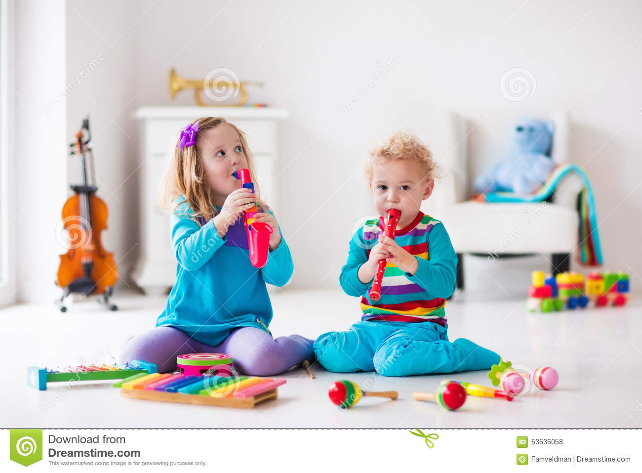 Boy and girl playing flute stock photo. Image of care ...