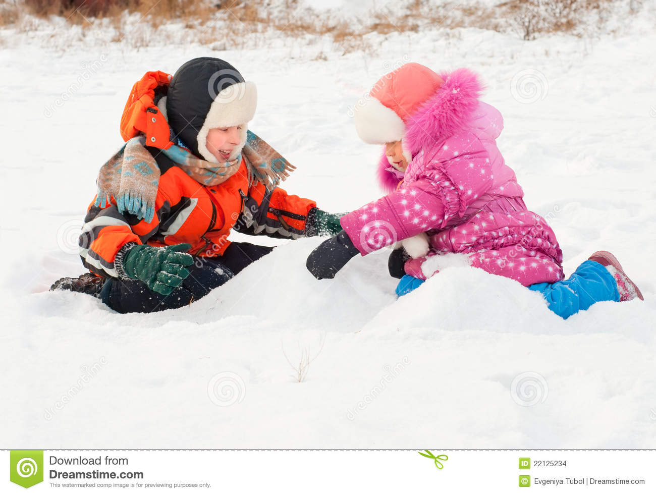 Boy and girl playing on the snow