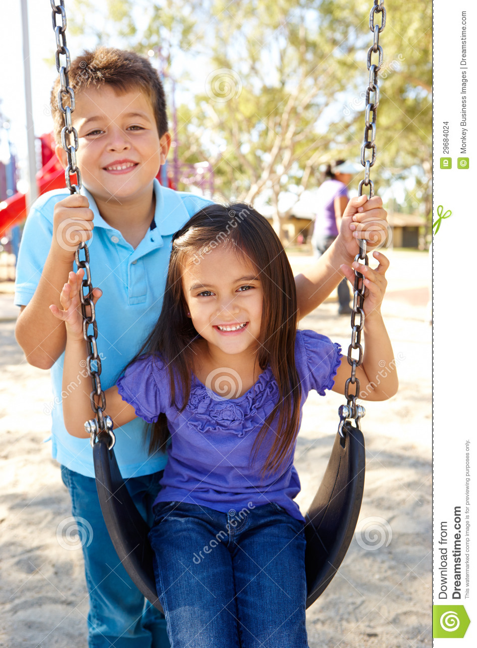 Boy And Girl Playing On Swing In Park Stock Photo - Image -3448