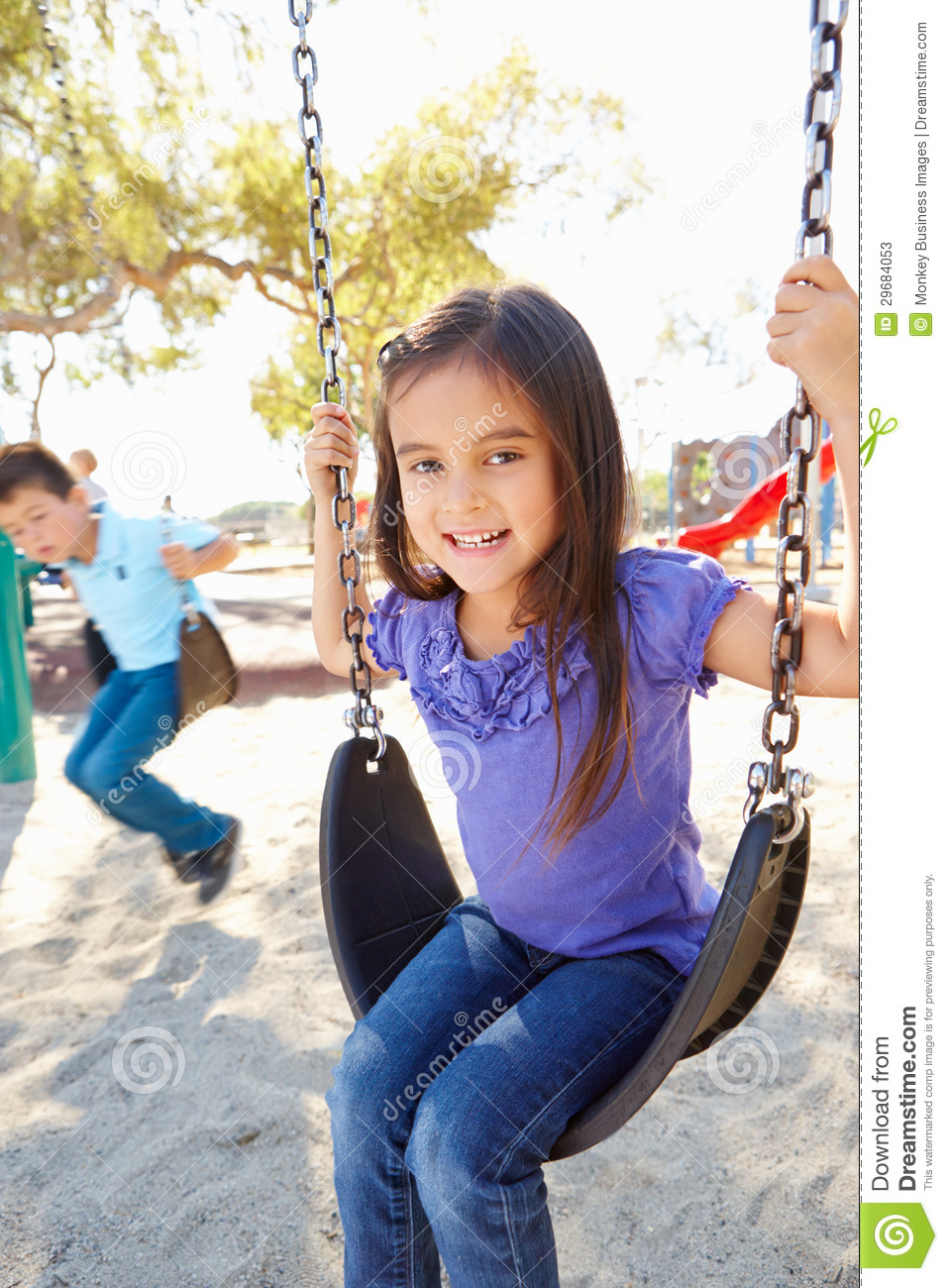 Boy And Girl Playing On Swing In Park Royalty-Free Stock -3393