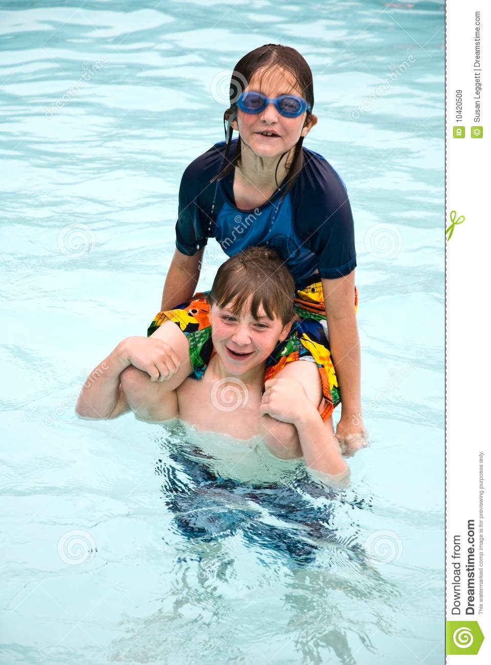 Naughty Boy And Girl Playing In Water Royalty Free Stock