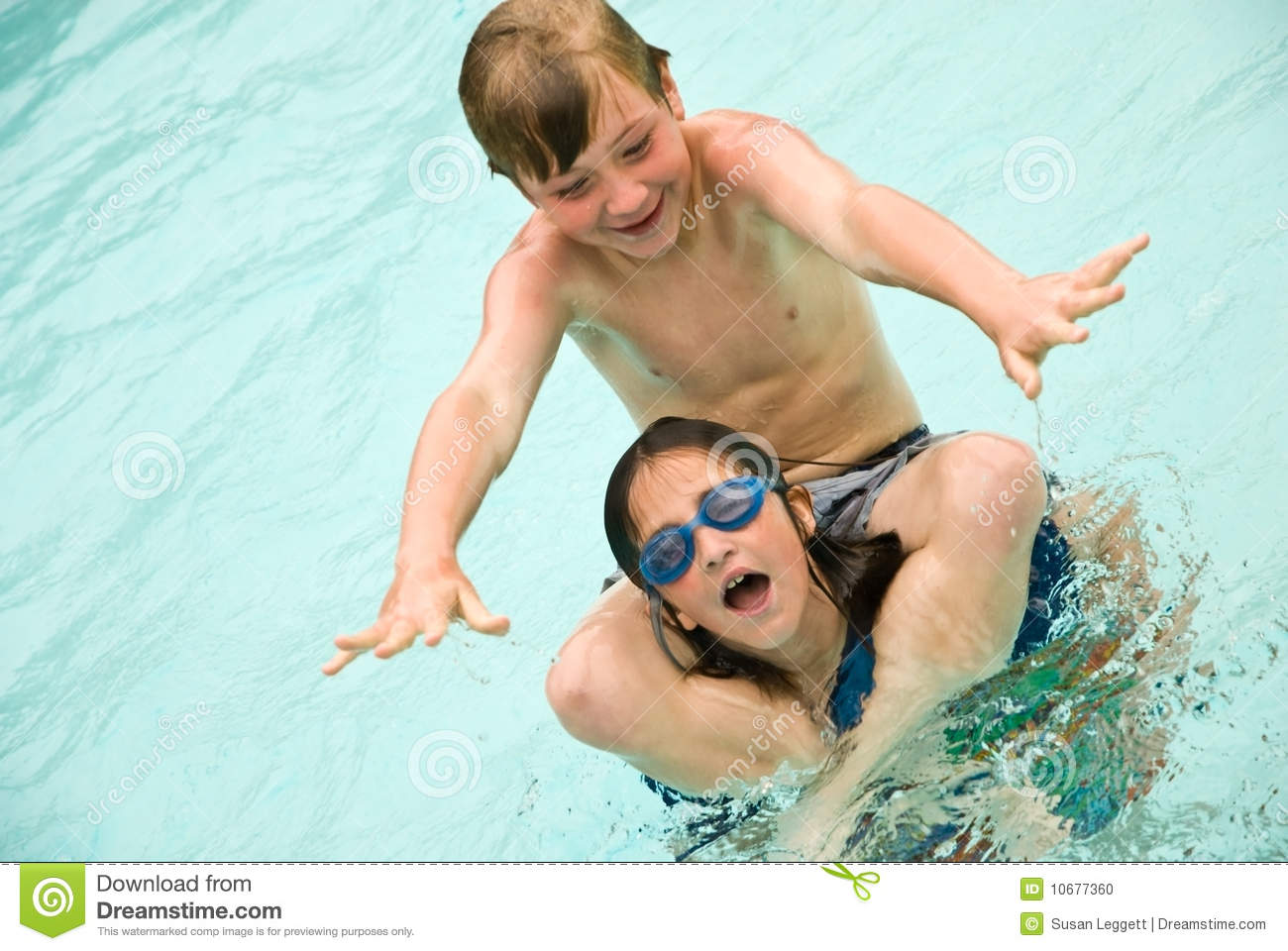 Boy and Girl Playing in the Water