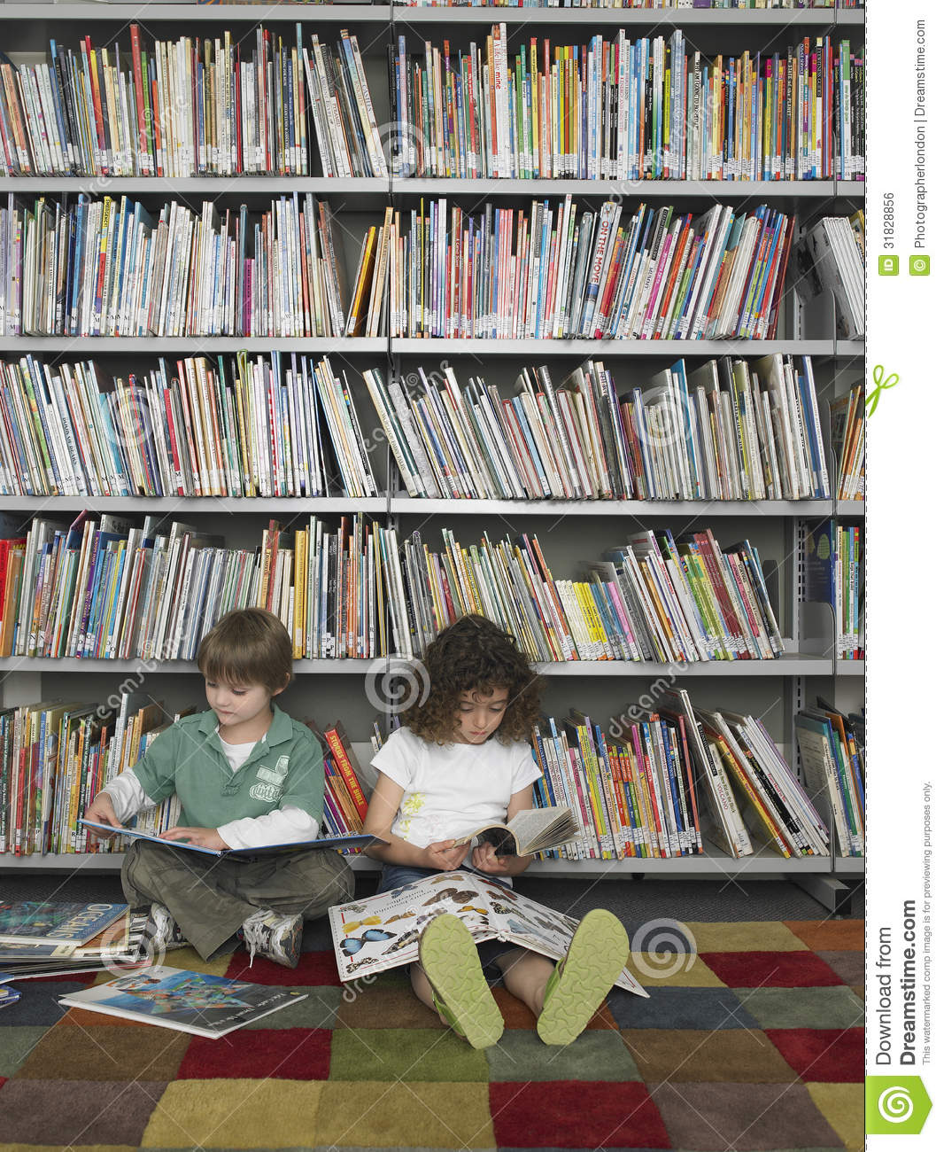 What I Blog About When I Blog About Books Notd Girl On: Boy And Girl Reading Books In Library Stock Photo