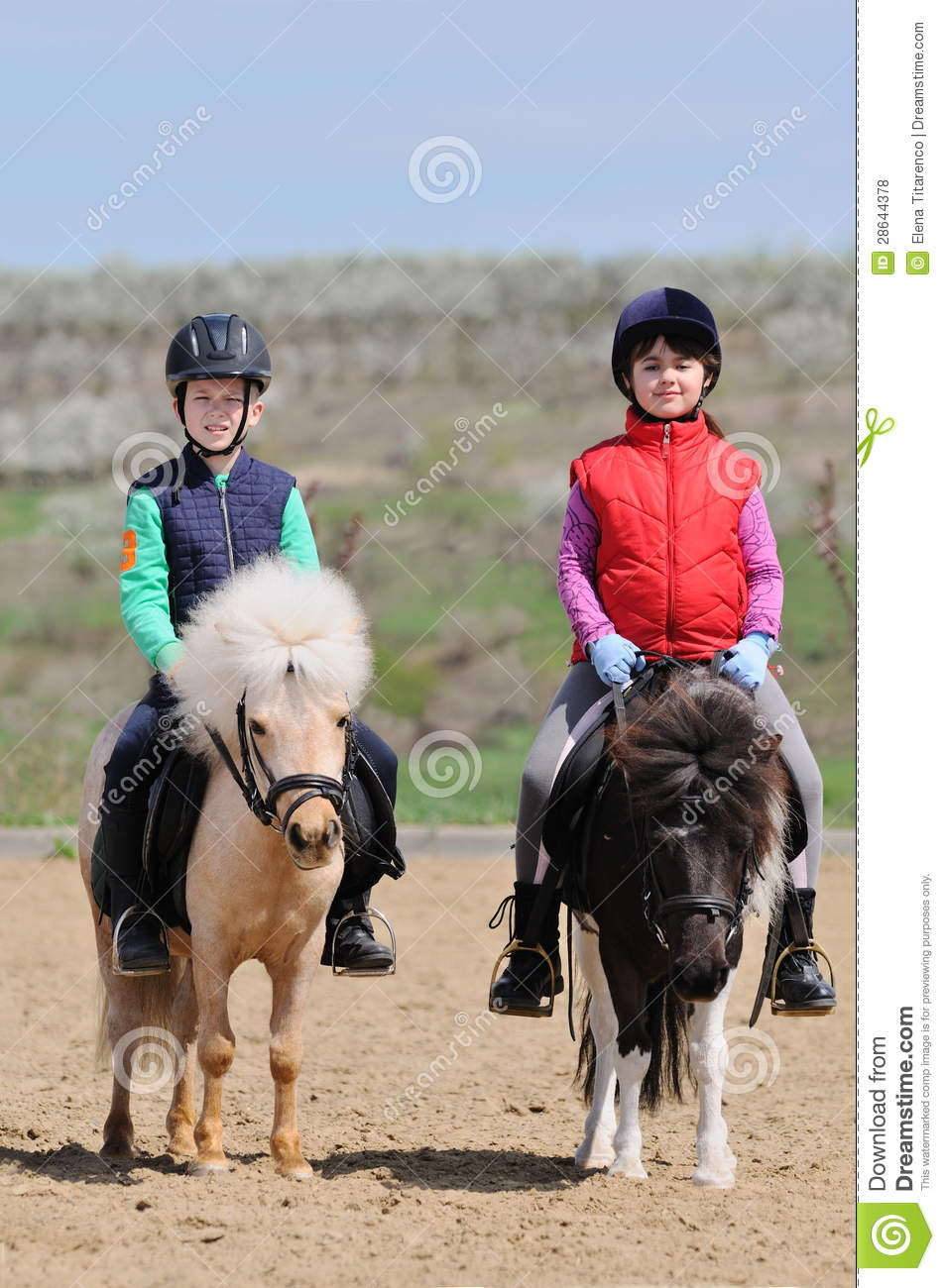 Boy And Girl Riding Ponies Royalty Free Stock Photos