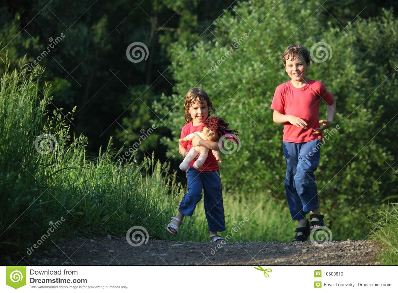 Boy And Girl Run With Doll In Park Stock Photo - Image ...