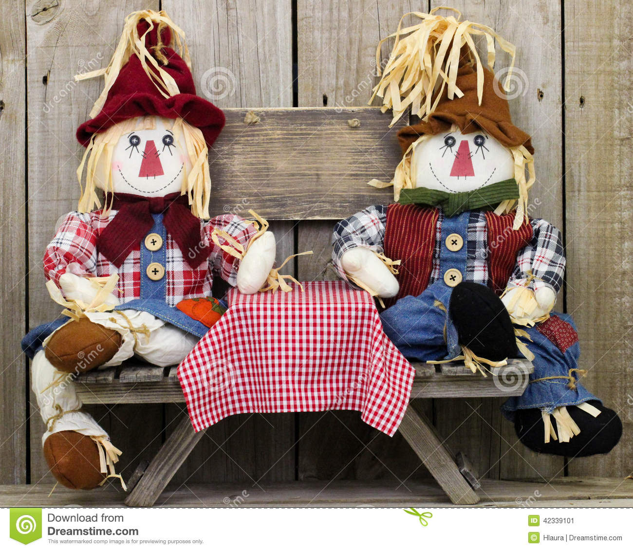 Boy And Girl Scarecrows Sitting At Picnic Table With Blank