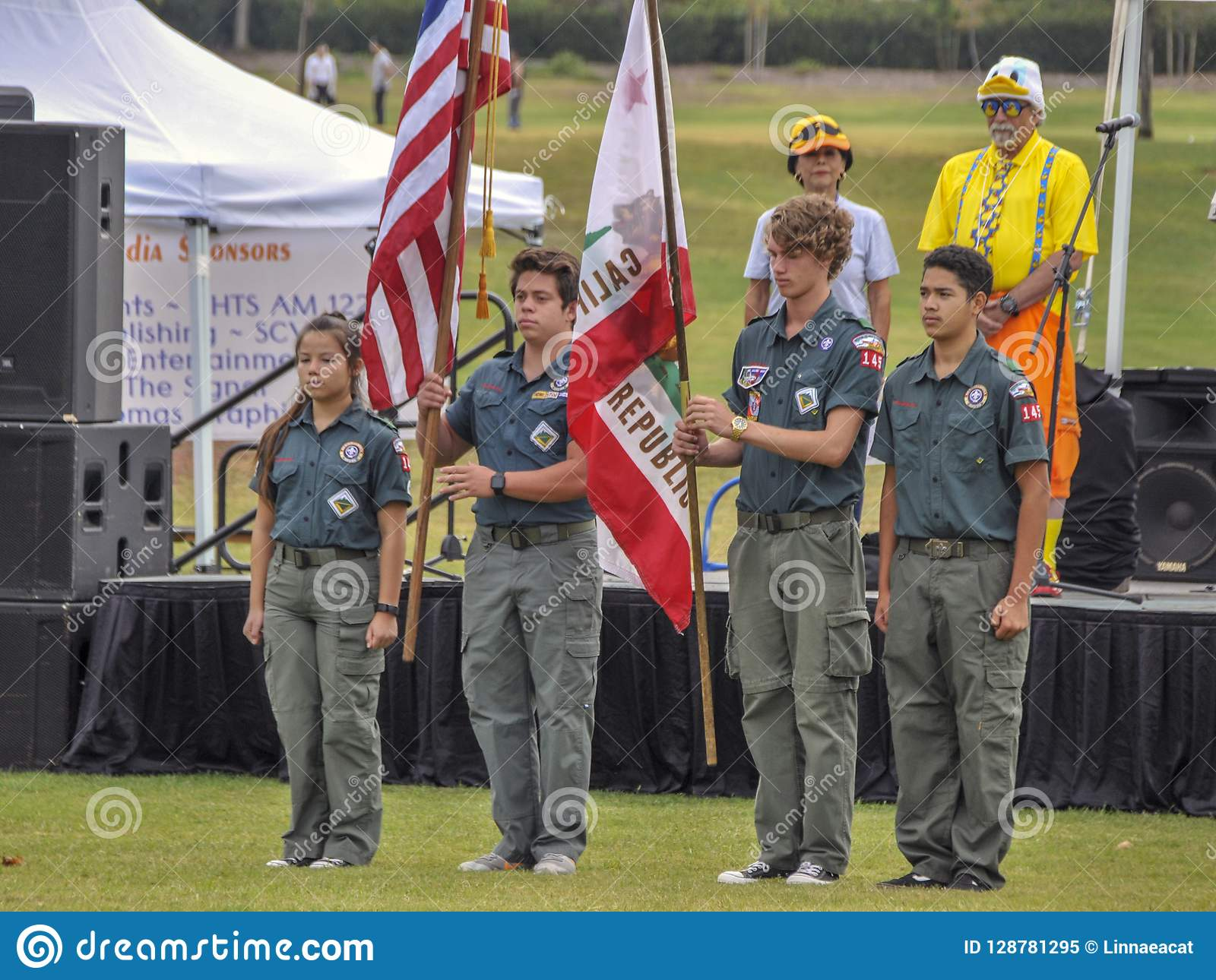 Boy and Girl Scouts Hold the American Flag during the National Anthem at the Annual Rubber Duck Festival.