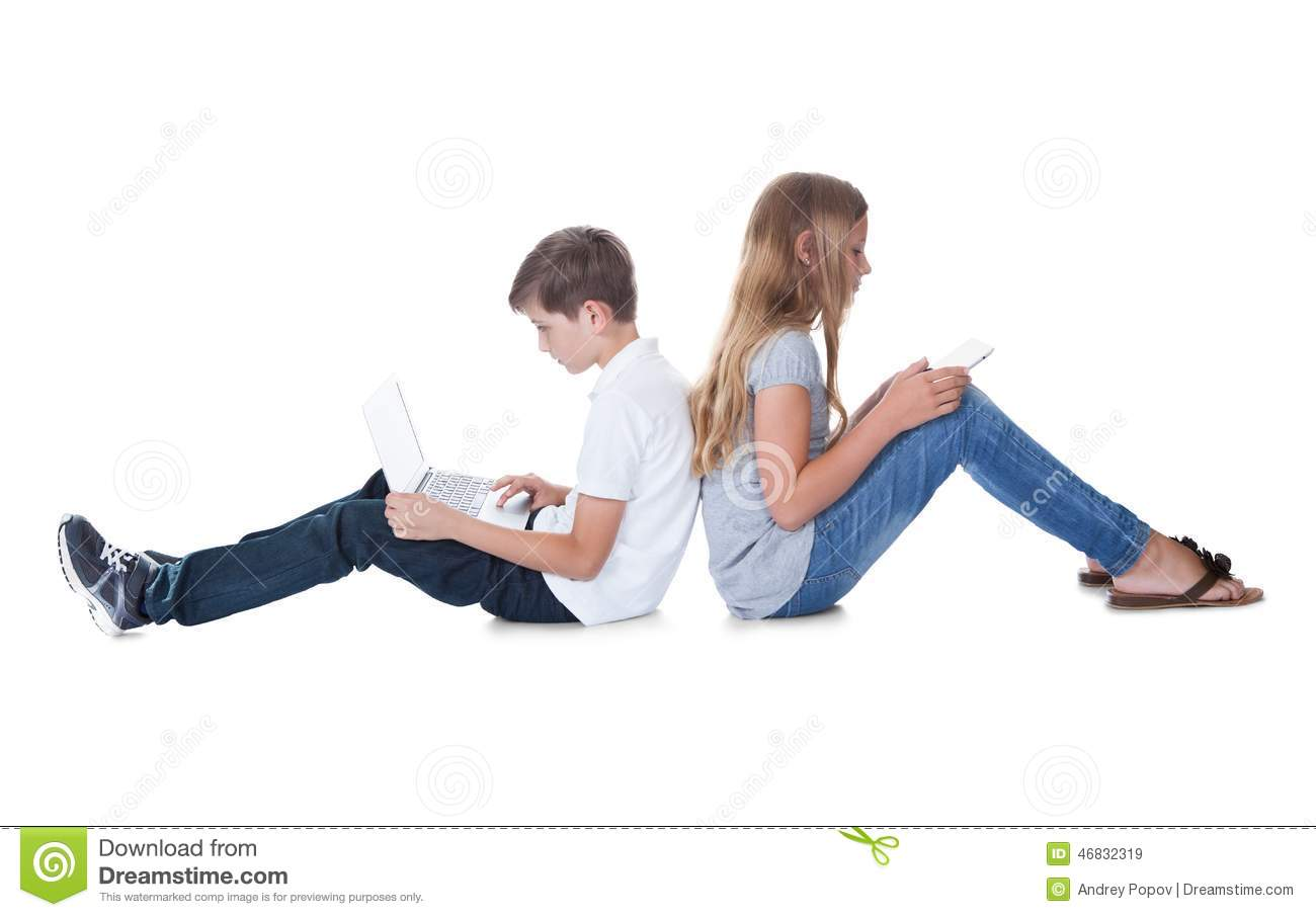 Boy And Girl Sitting Back To Back Using Laptop And Digital Tablet ...
