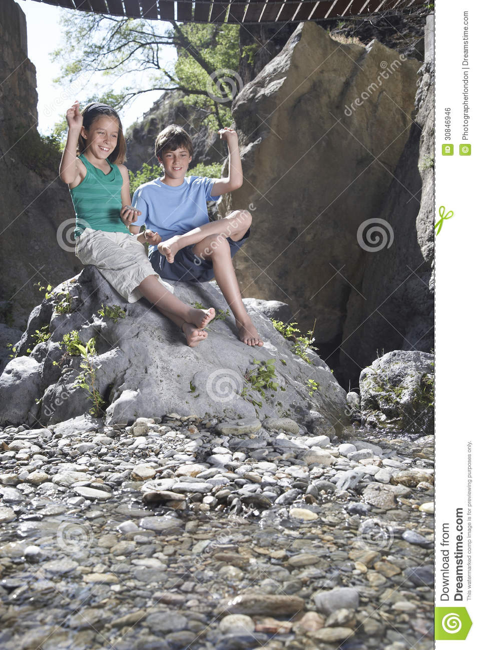 Love stick girl sitting on rock just ridiculously
