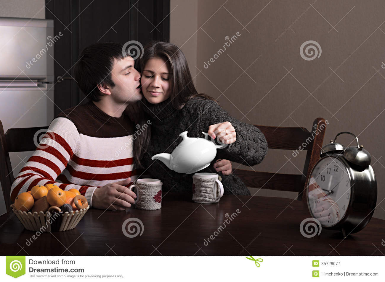 Boy And Girl Sitting At A Table And Drinking Tea Royalty