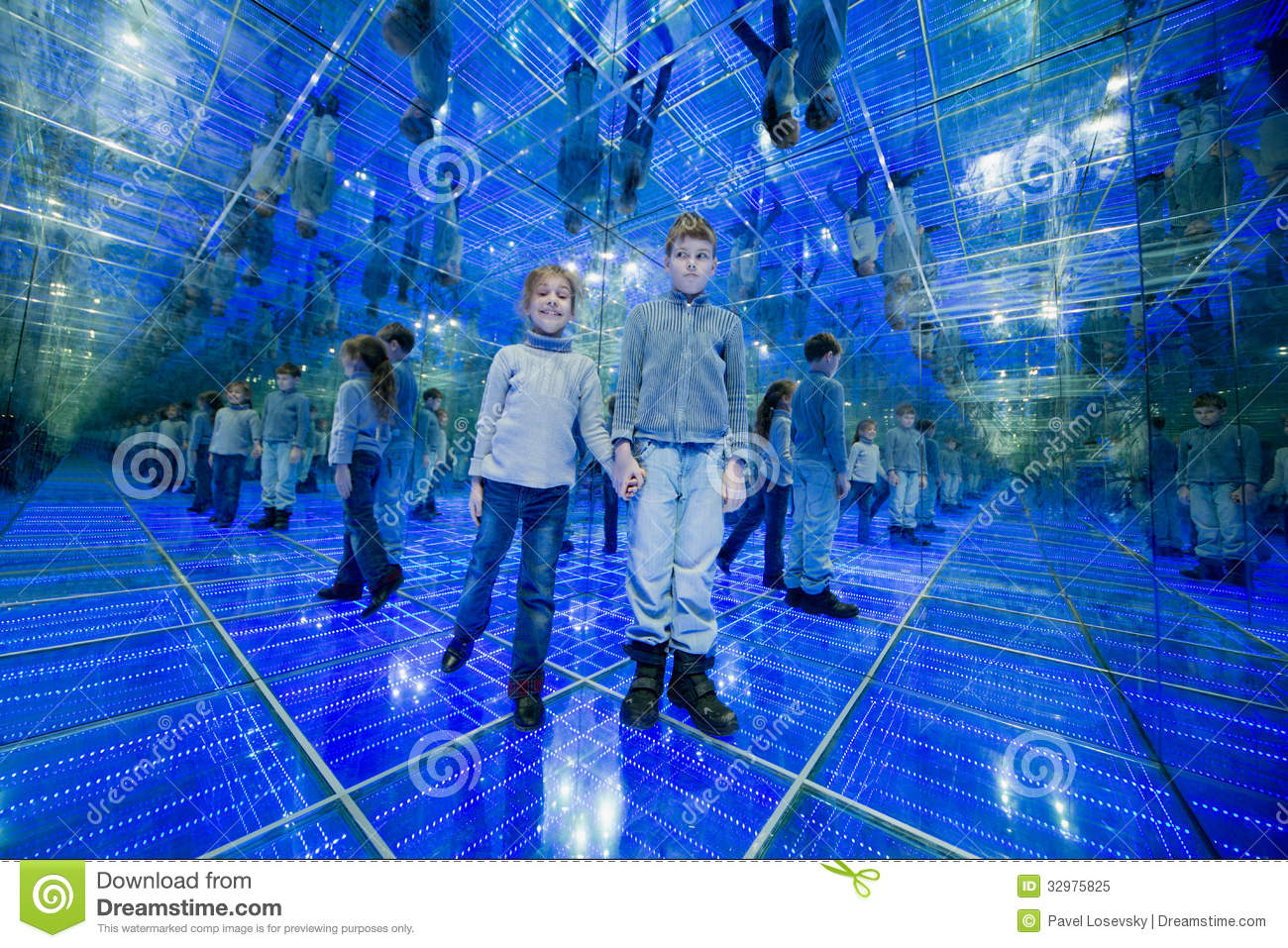 Boy and girl standing in a mirrored room