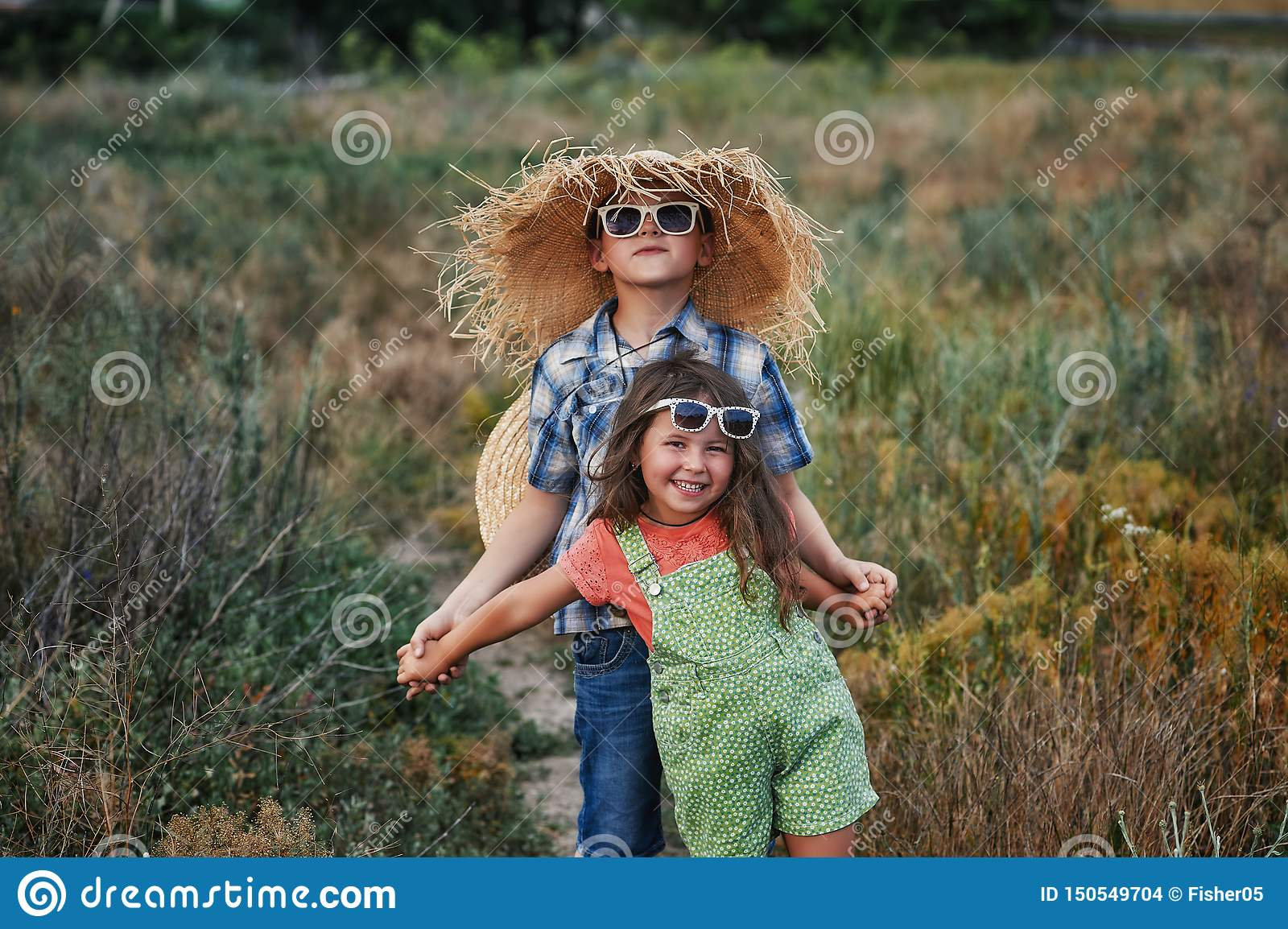 Boy and girl on a summer walk in the countryside