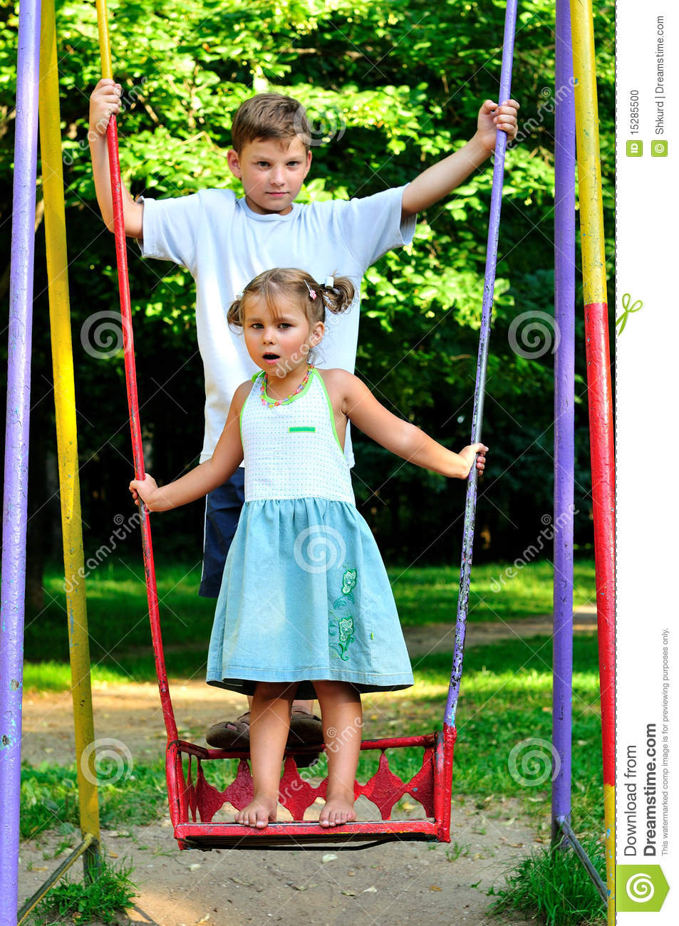 The boy and the girl on a swing