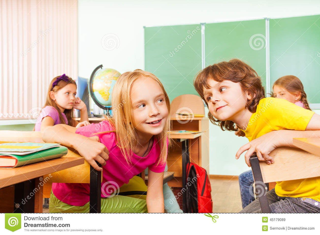Boy And Girl Talking To Each Other At School Stock Photo