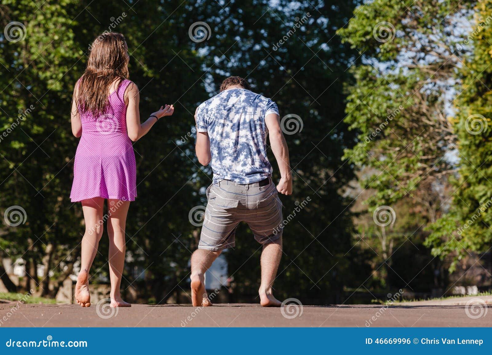 A Boy Walking Away From A Girl Boy Girl Walking Away Talking