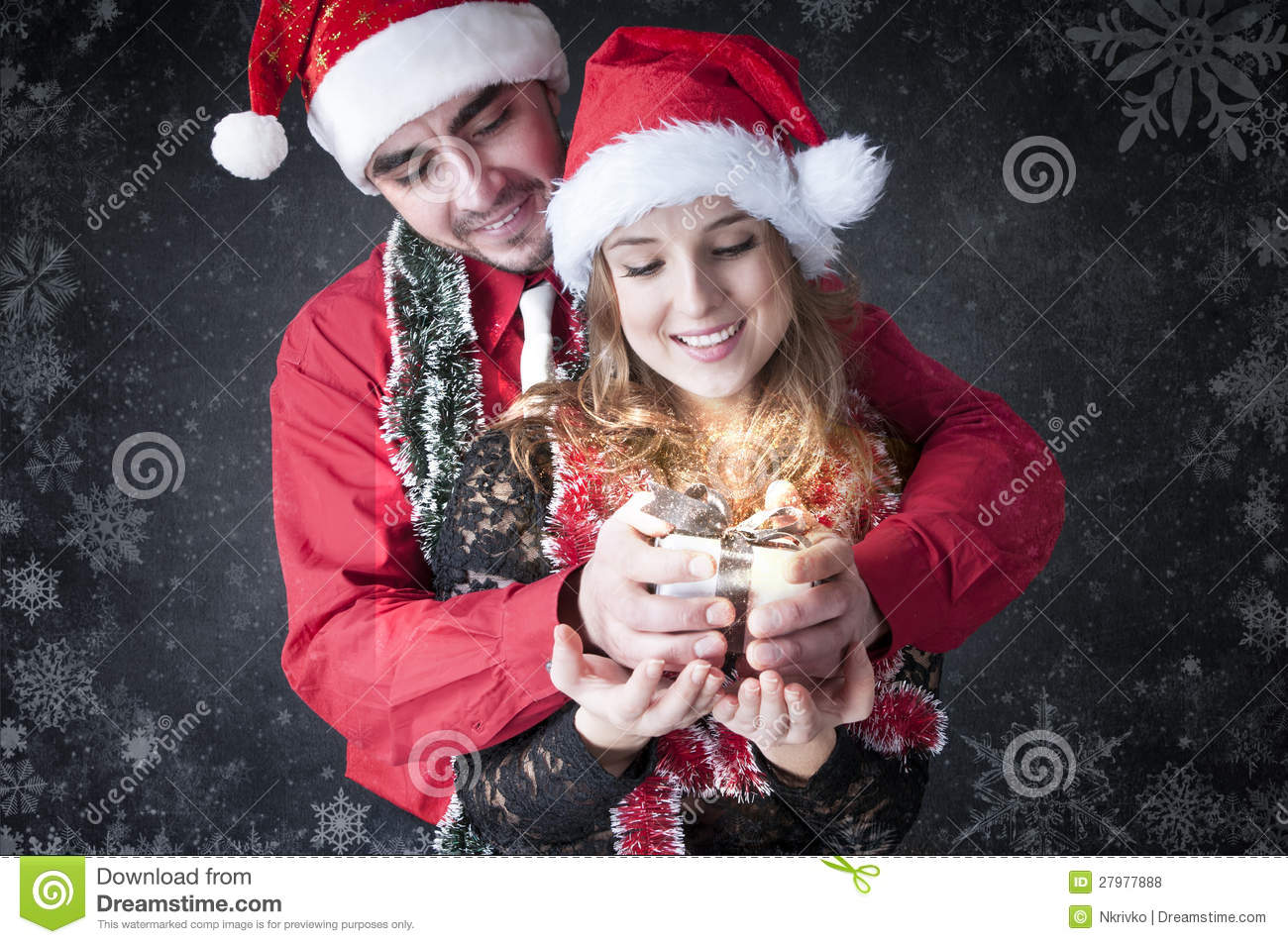 Boy Give A Christmas Gift To Her Girlfriend Stock Photo