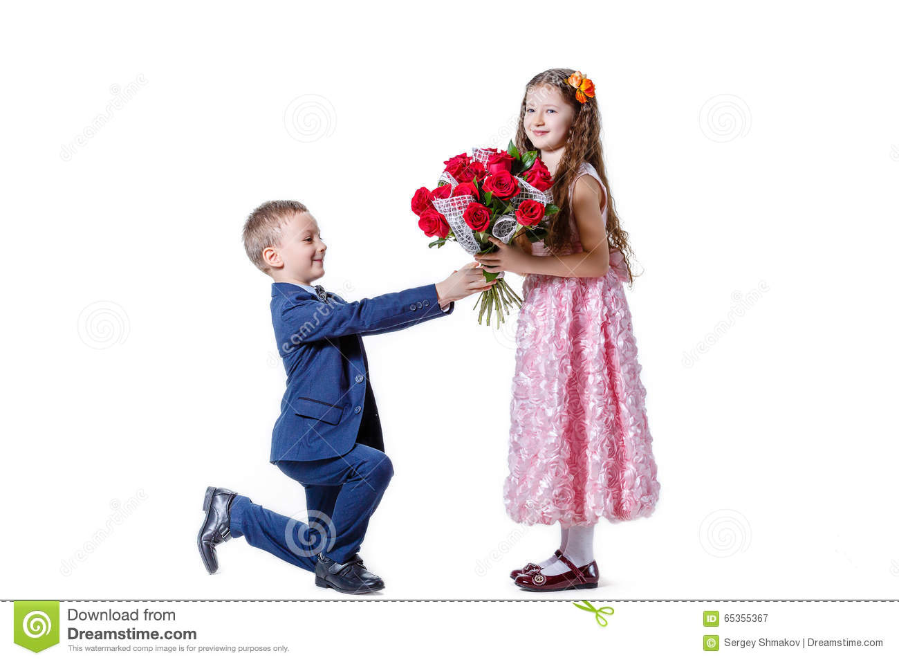 Boy Gives A Girl Flowers On The Day Of St Valentine