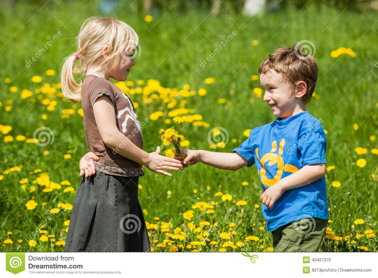 Boy giving flowers for a girl stock photo image of children field boy giving flowers for a girl stock photo image of children field 40457370 izmirmasajfo
