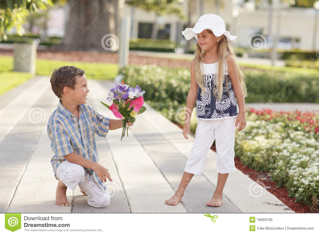 boy giving flowers to the girl royalty free stock photo Shopping Graphics Shopping Clip Art