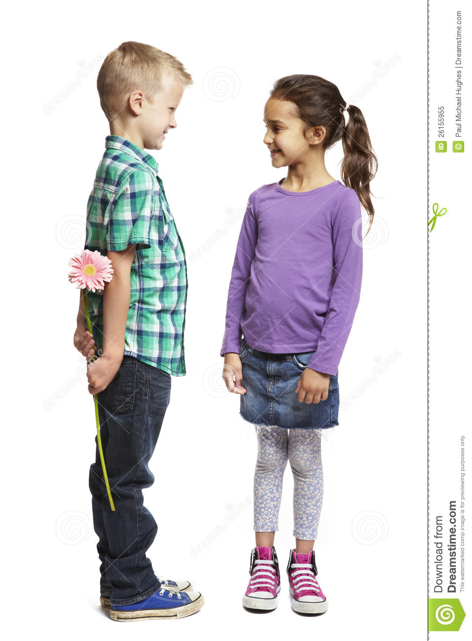 Boy And Girl Bedroom Decor: Boy Giving Pink Flower To Girl Stock Image