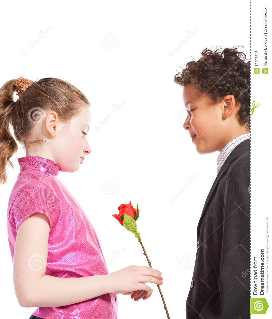 Boy Giving Pretty Girl A Kiss Royalty Free Stock Image