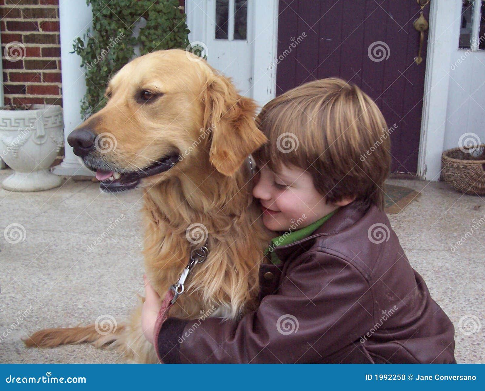 Boy and golden retriever portrait