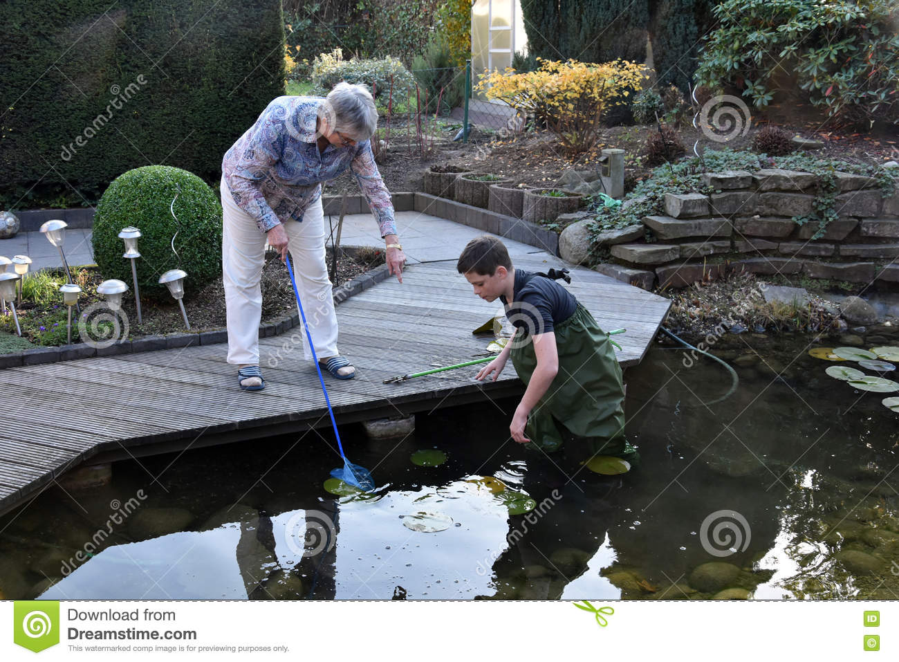Boy And Grandmother Cleaning Garden Pond Stock Photo Image 79747297