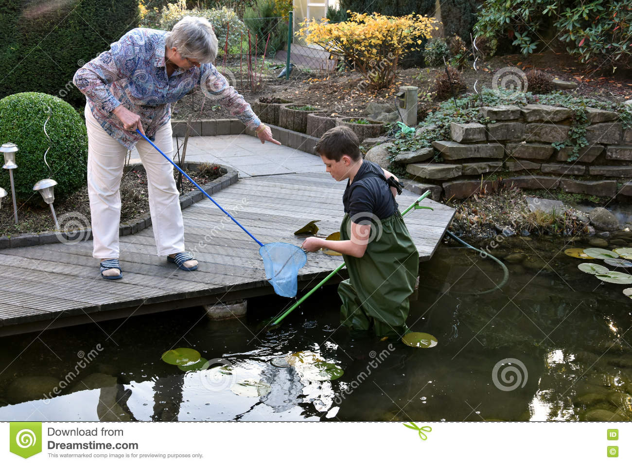 Boy And Grandmother Cleaning Garden Pond Stock Photo Image 79749808