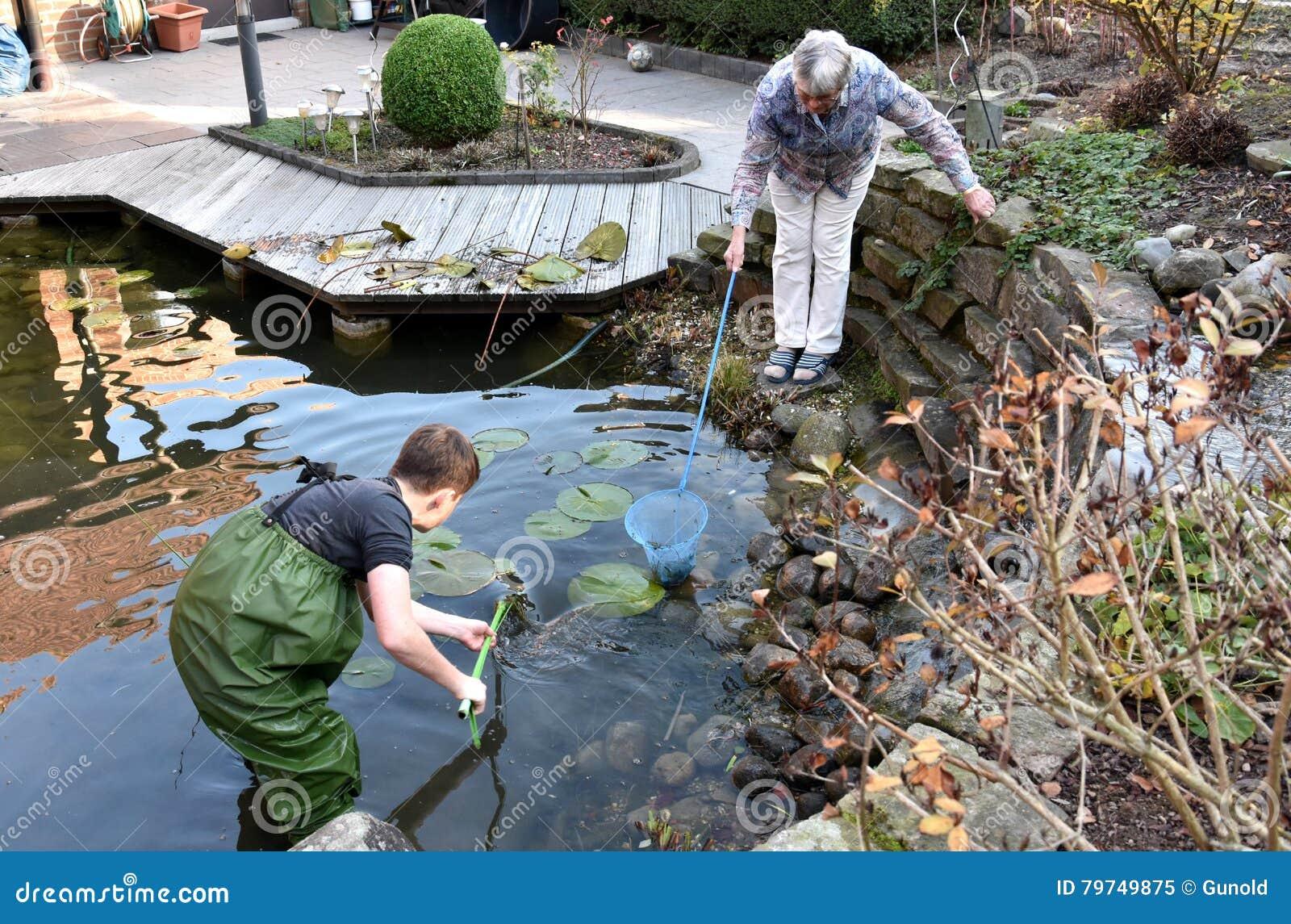 Boy cleaning garden pond stock photography cartoondealer for Pond dealers