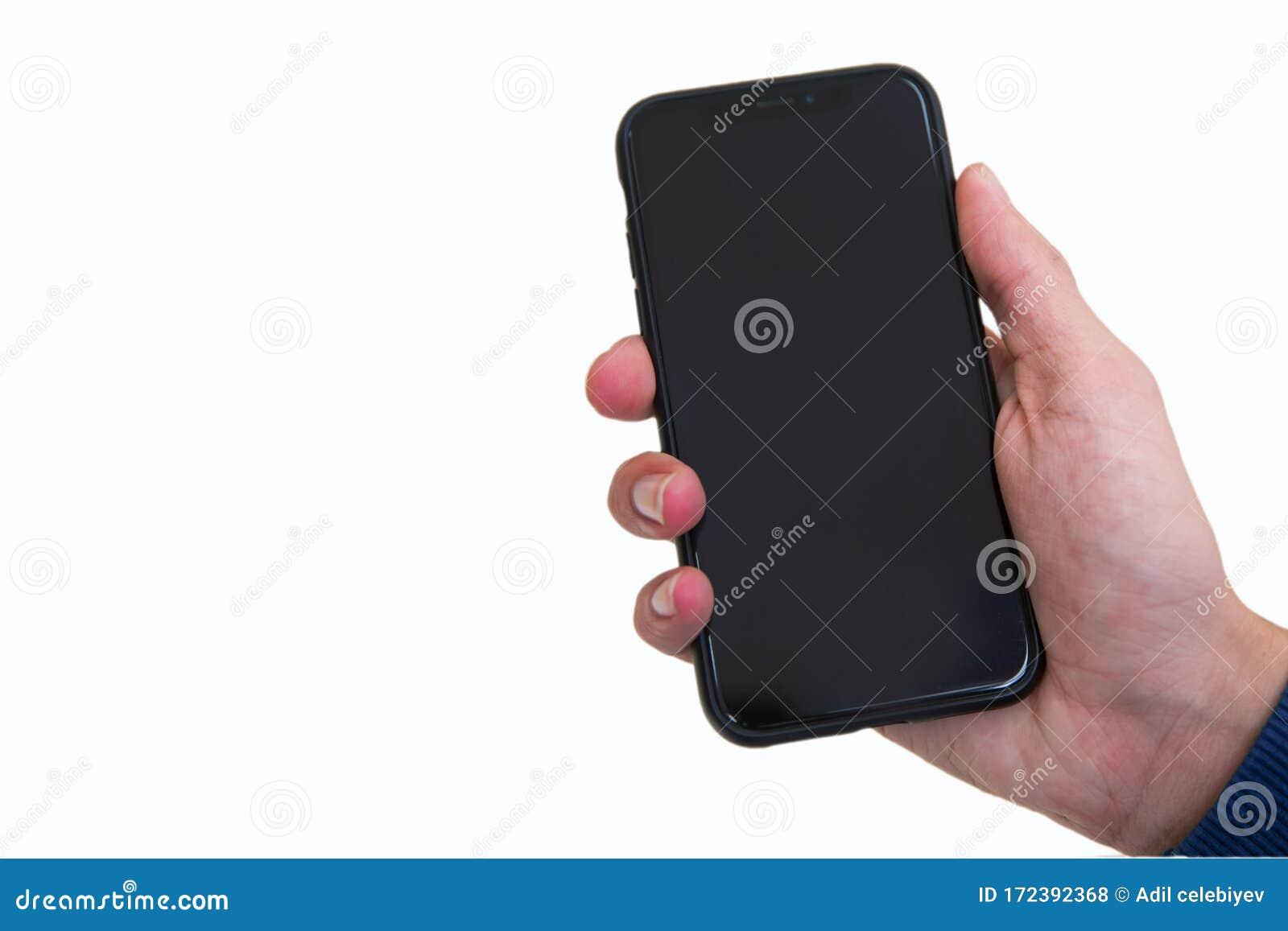 boy hand holding black modern smartphone empty screen isolated white background mockup man presenting smart phone 172392368