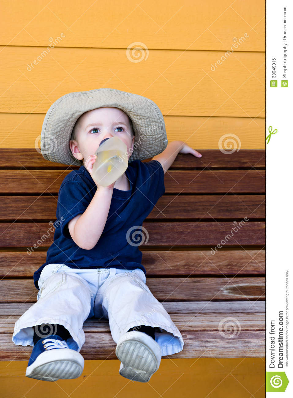 boy having a drink of water stock photo