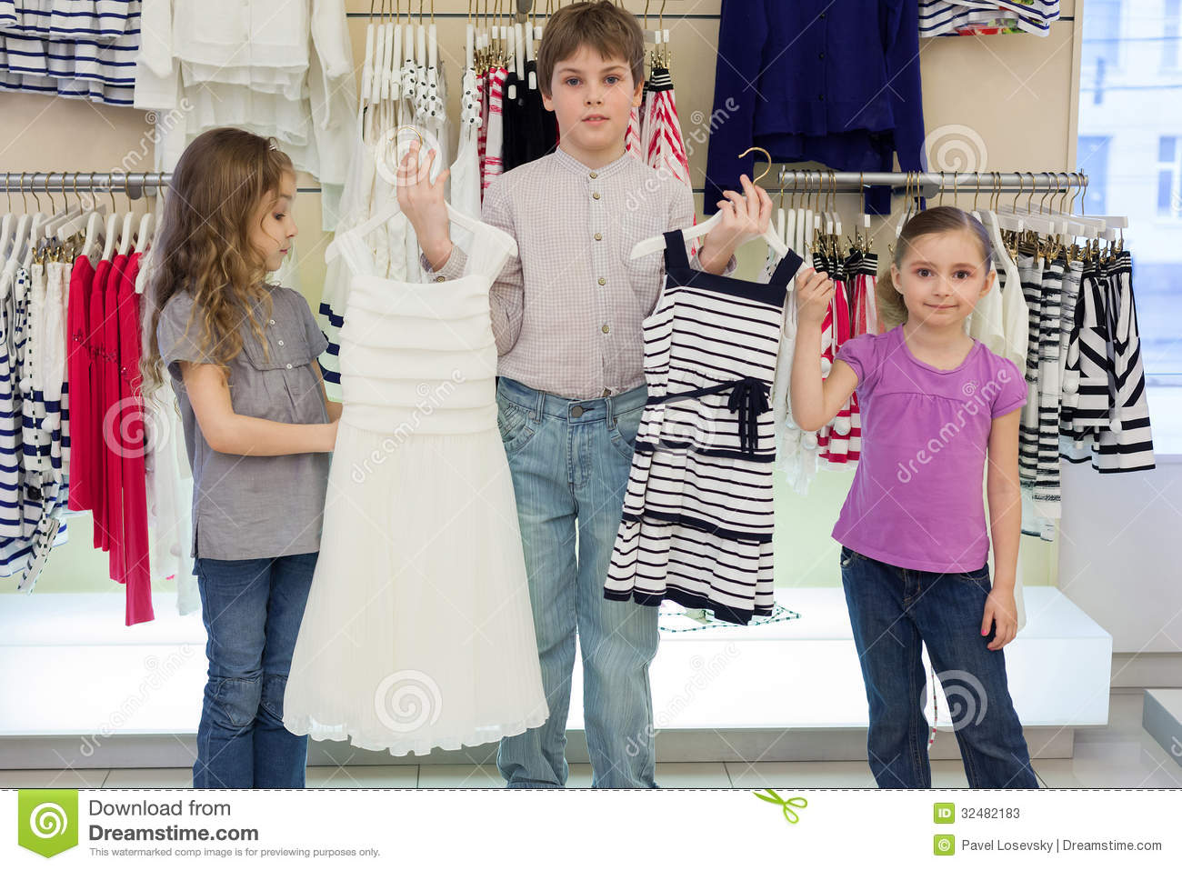 The Boy Helps Cute Girls To Choose Dress In Shop Stock Photos ...