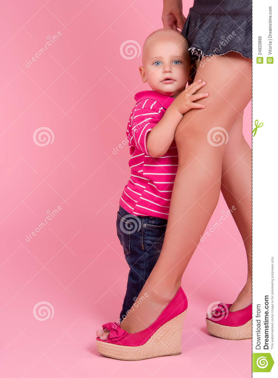 Boy hides behind mom feet royalty free stock image image 24920886