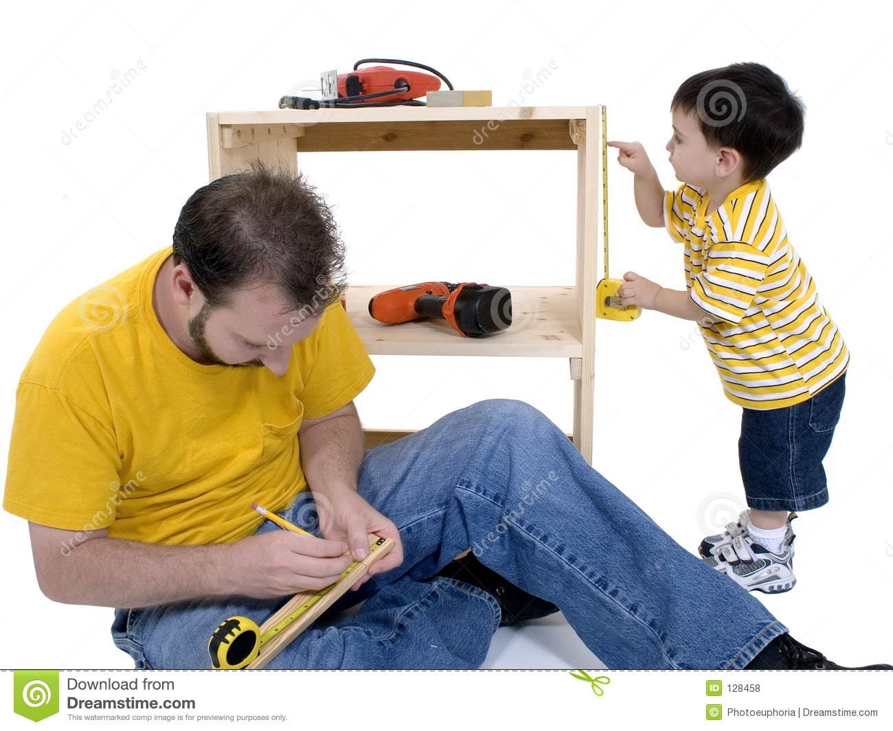 Boy And His Father Building A Storage Cabinet Together