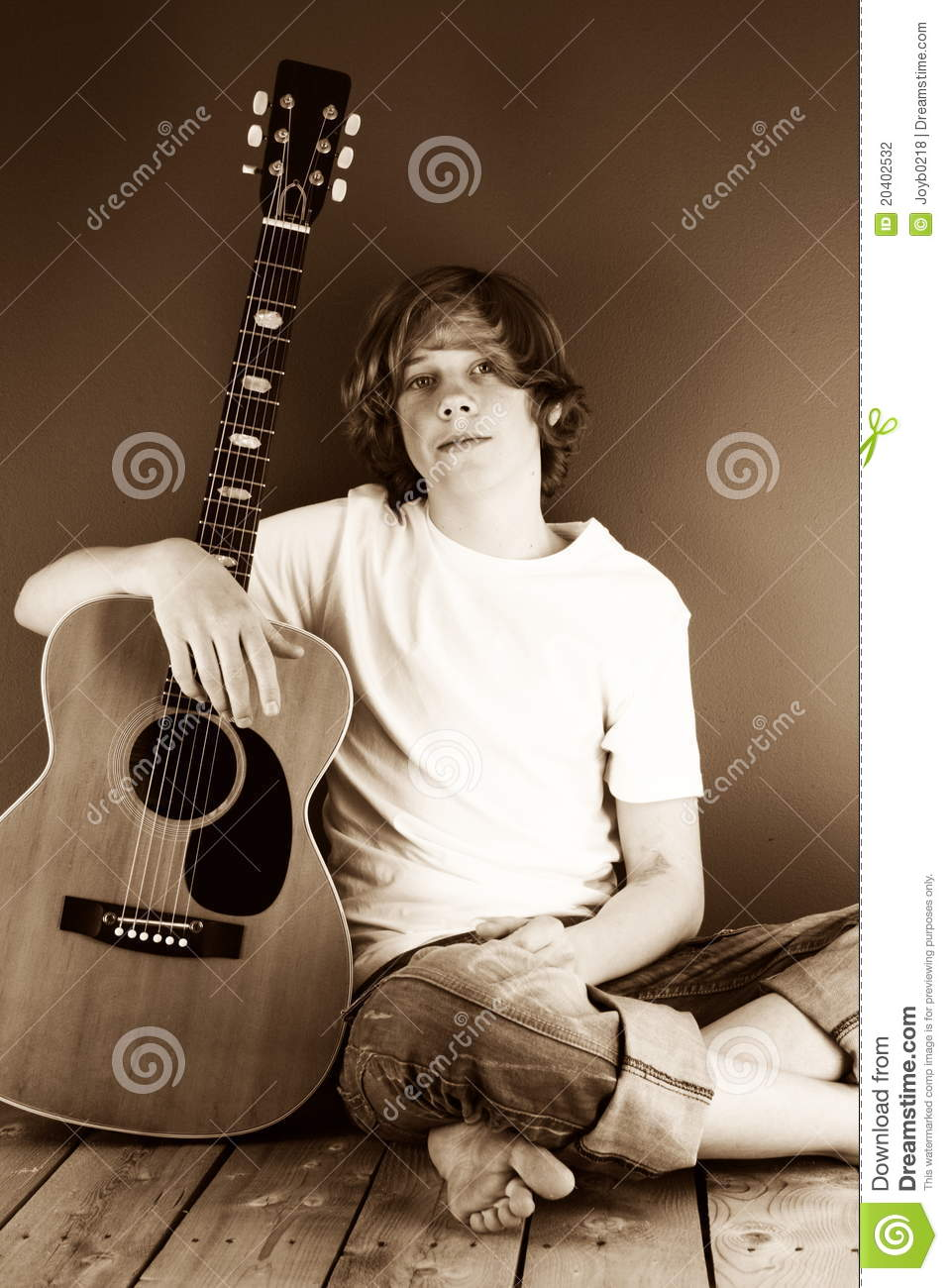 Boy With His Guitar In Sepia Stock Photography Image