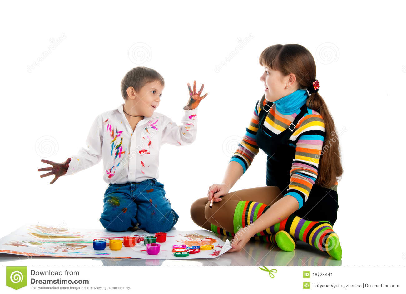 Boy and his mom play with bright paint