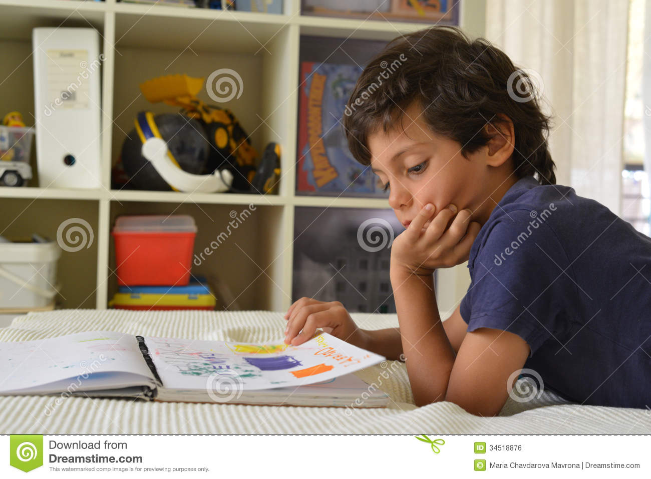 Boy In His Room Watching Comics Royalty Free Stock Image