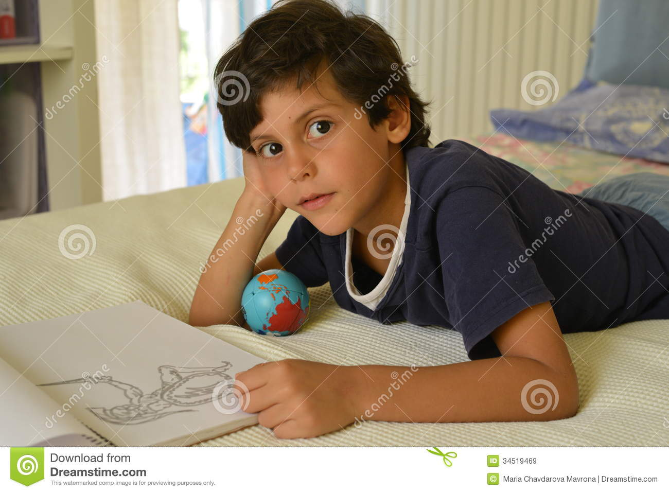 Boy In His Room Watching Comics Royalty Free Stock Images