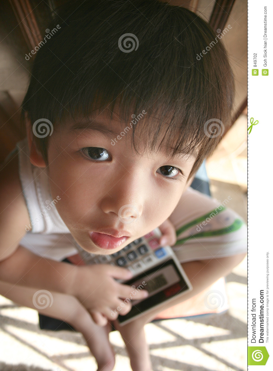 Boy holding calculator looking up