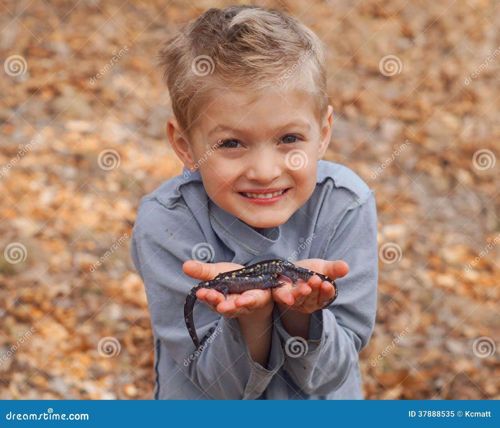 Boy holding salamanders