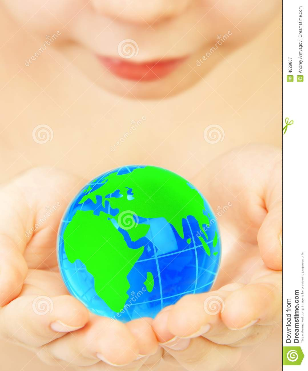 Boy holds globe in hands